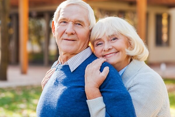 old couple feeling safe when eating healthy food